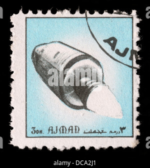 Stamp printed in emirate Ajman show spaceship, circa 1972 - Stock Photo