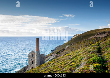 The coast at St Agnes in Cornwall with the Wheal Coates tin mine perched on the edge of the cliffs. - Stock Photo