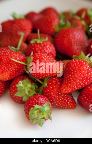 Small strawberries on a plate - Stock Photo