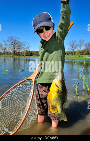 Young boy fishing in a Pennsylvania pond - Stock Photo