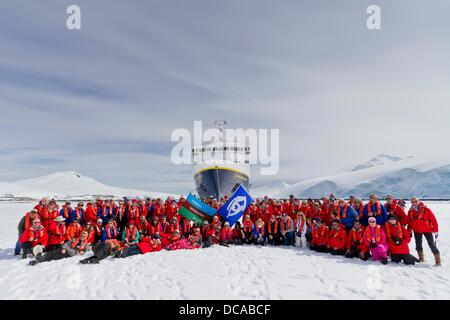 Guests from the Lindblad Expedition ship National Geographic Explorer gather on sea ice in Antarctica - Stock Photo