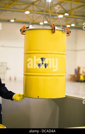 yellow barrel with radioactive waste disposal - Stock Photo