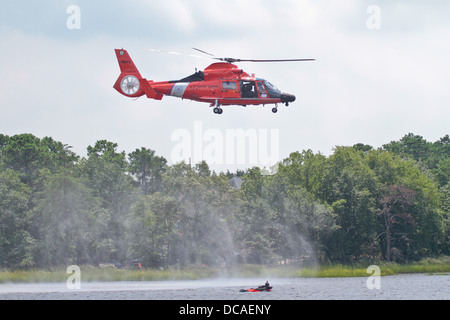 U.S. Air Force airmen from the 177th Fighter Wing, New Jersey Air National, and a rescue aircrew flying an HH-65C - Stock Photo