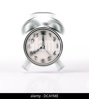 Classic Alarm clock chromed ringing, with movement effect. Front view on white background, with slight reflection - Stock Photo