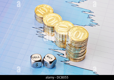 Dices cubes with the words SELL BUY, uptrend stacks of golden coins and financial chart as background. Selective - Stock Photo