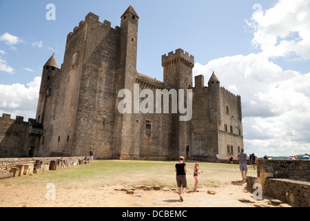 Tourists at the 12th century medieval Chateau de Beynac castle;  Beynac et Cazenac, the Dordogne France Europe - Stock Photo