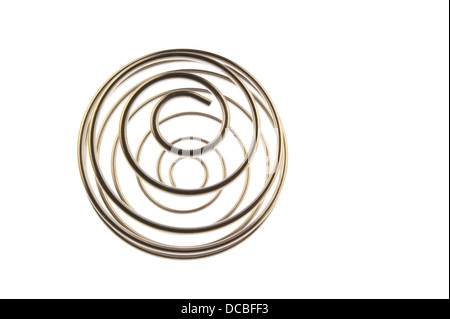 Iron wire tangled up into a spiral ball resulting in a shiny chrome sphere and viewed at its north pole and isolated - Stock Photo