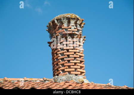 Unusual style of brick chimney on an old French house in the Vendee region of France - Stock Photo