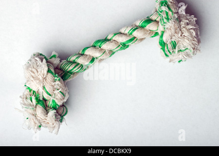 Knotted rope dog toy on white surface - Stock Photo