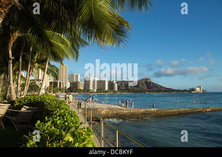 View of Diamond Head and coastline from Sheraton Waikiki Beach Hotel - Stock Photo