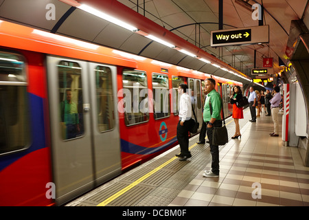 train arriving at docklands light railway dlr underground station London England UK - Stock Photo