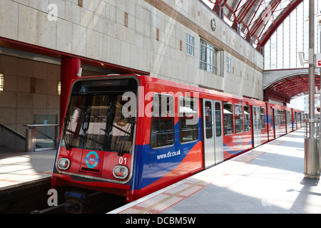 train leaving docklands light railway dlr canary wharf station London England UK - Stock Photo