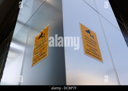 premises under cctv surveillance signs in canary wharf London England UK - Stock Photo