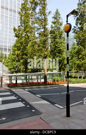 modern belisha beacon zebra pedestrian crossing canary wharf London England UK - Stock Photo