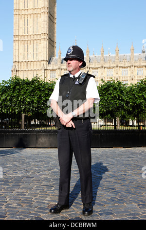 british metropolitan police office guarding the houses of parliament London England UK - Stock Photo