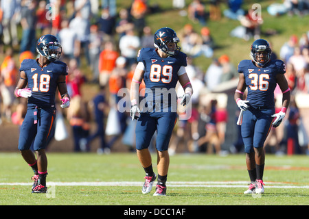 Virginia Cavaliers wide receiver Kris Burd (18), tight end Colter Phillips (89) and fullback Max Milien (36) line - Stock Photo