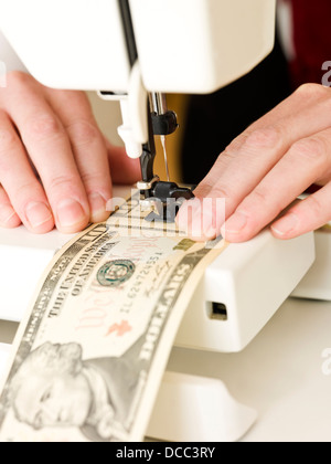 Sewing money - Stock Photo