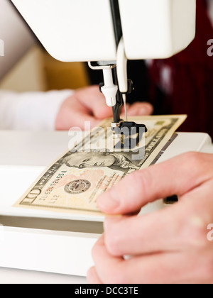 Sewing a dollar bank note - Stock Photo