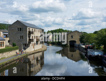 Two cyclists on the towpath of the Calder & Hebble Navigation at Elland, West Yorkshire, England UK - Stock Photo