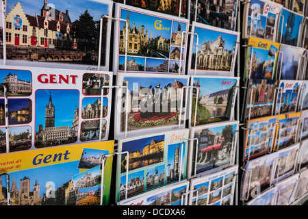 Tourist postcards from the historic city center of Ghent on display in rack of souvenir shop, East Flanders, Belgium - Stock Photo