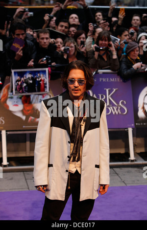 US actor Johnny Depp arrives on the red carpet to attend the UK premiere of the film 'Dark Shadows' in London on - Stock Photo