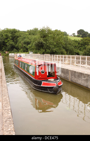 Avoncliff aqueduct a narrow boat on the Kennet and Avon canal between Limpley Stoke and Bradford On Avon England - Stock Photo
