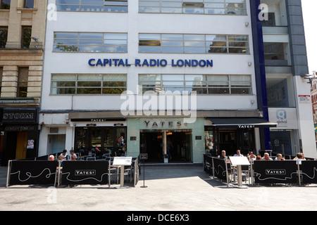capital radio London and yates wine bar England UK - Stock Photo
