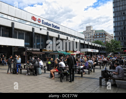 Concrete concourse and shops at Euston Station London - Stock Photo