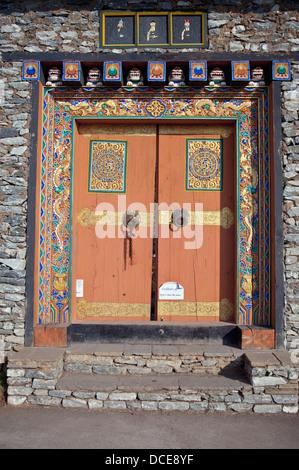 Painting On Doorway In Rock Wall, Bhutan - Stock Photo