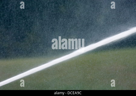 A water line spray from a fire department hoseline - Stock Photo