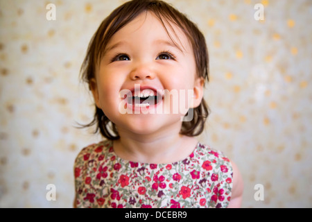 16 months old smiling baby girl - Stock Photo