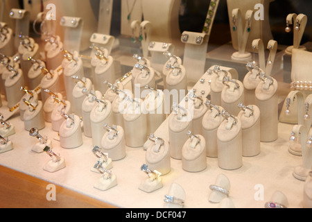 diamond rings in the window of a jewellers shop in hatton garden London England UK - Stock Photo