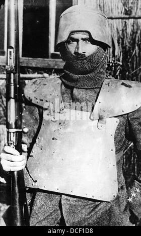 Great War. WW1 Italian soldier wearing body armor and helmet. - Stock Photo
