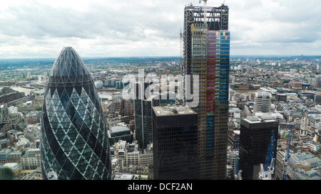 Aerial high view looking south over London of the 122 Leadenhall St building the Cheesegrater and the Gherkin in - Stock Photo