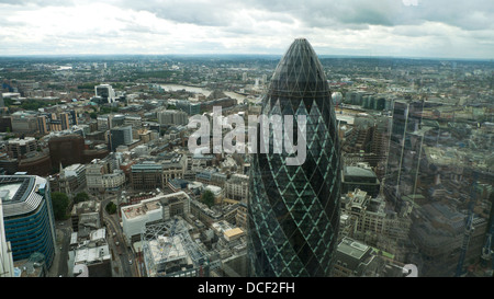 London skyline high aerial view looking south east over the gherkin building at 30 St Mary Axe City of London UK - Stock Photo