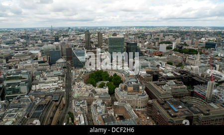 Aerial view north west along London Wall over Broadgate, Finsbury Circus, City Point, Barbican in the City of London - Stock Photo