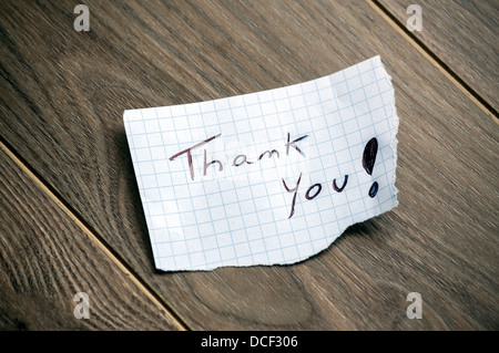 Thank you - Hand writing text on wood background - Stock Photo