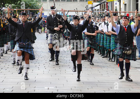 Glasgow, Scotland, UK, Friday, 16th August, 2013. Four Pipe Bands taking part in the traditional Beat The Retreat - Stock Photo