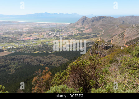 Aerial view of fire watch cabin, Cape Town suburbs and False Bay from slopes of surrounding mountains - Stock Photo