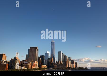 moon rise over lower Manhattan - Stock Photo