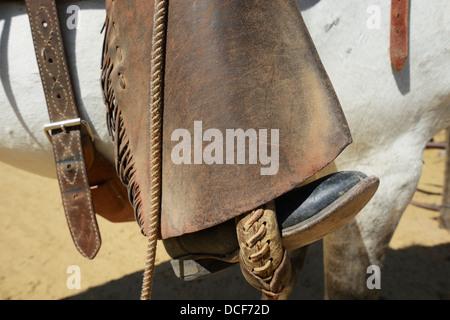 Close-Up Of Cowboy His Chaps And His Horse;Arizona Usa - Stock Photo