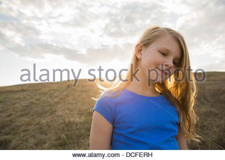 Portrait of schoolgirl standing outdoors - Stock Photo