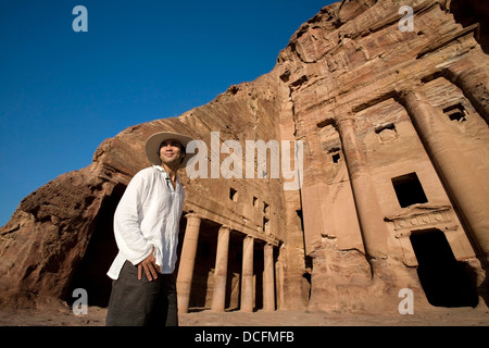 Man Standing By Royal Tomb In Petra - Stock Photo