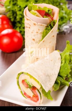 Selective focus on the tortilla sandwich below - Stock Photo