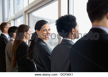 Businesswoman looking over shoulder - Stock Photo