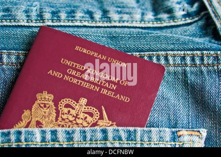 Passport in rear pocket - Stock Photo