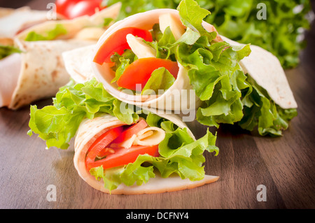 Selective focus on the tortilla wrap on top - Stock Photo
