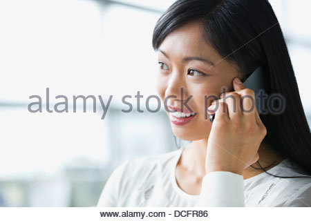 Close-up of businesswoman talking on smart phone - Stock Photo