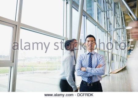 Portrait of confident businessman in office building - Stock Photo