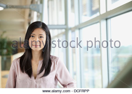 Portrait of beautiful businesswoman in office - Stock Photo